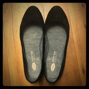 A black flat comfortable shoe